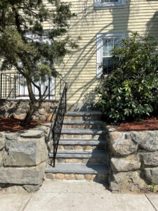 Wrought Iron Railing with stone and granite stairs