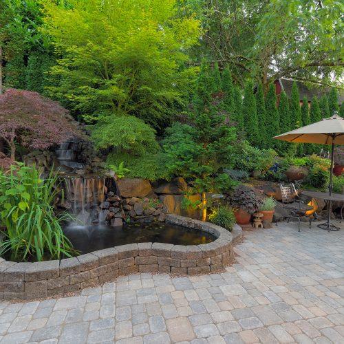 Backyard-Garden-landscaping-with-waterfall-pond-trees-plants-trellis-decor-furniture-brick-pavers-patio-hardscape2